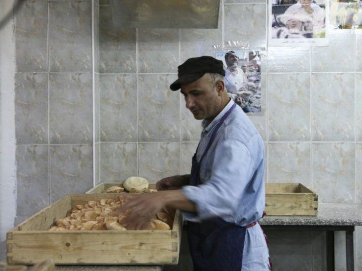 A baker making Jordanian flatbread.