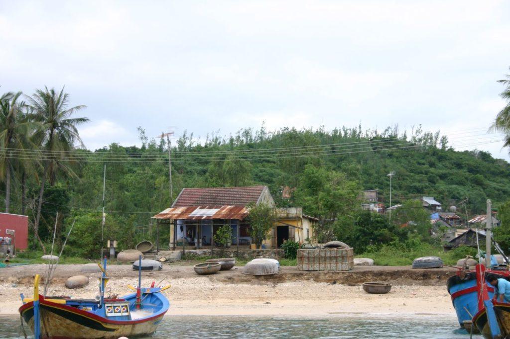 Round basket fishing boats on the shore near Nha Trang.