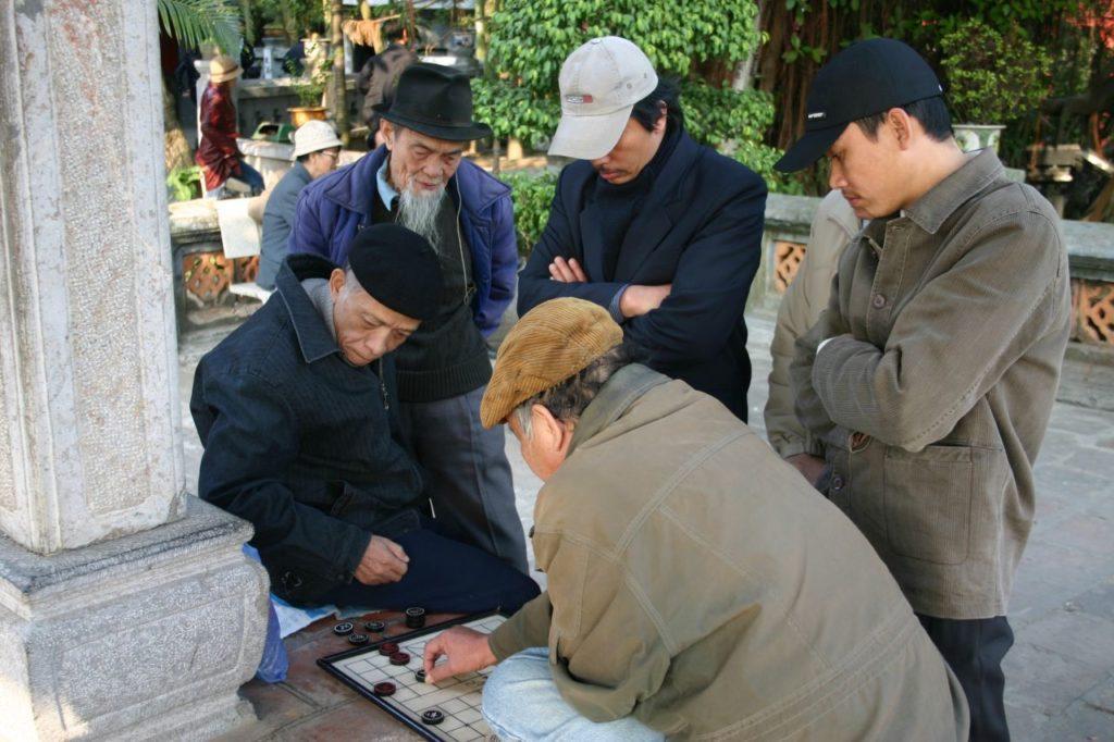 Men play Go in a Hanoi park.