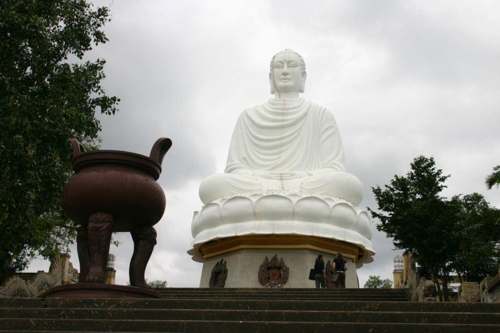 The massive white Buddha at the Long Son Pagoda.