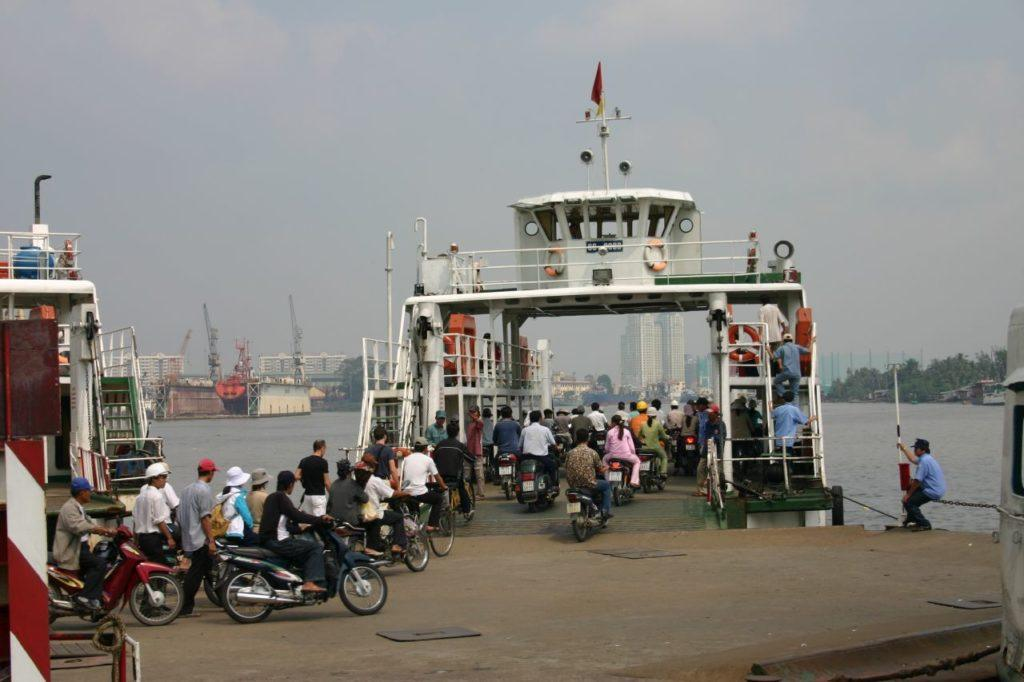 Dozens of motorcycles crowd onto a river ferry in Ho Chi Minh city.
