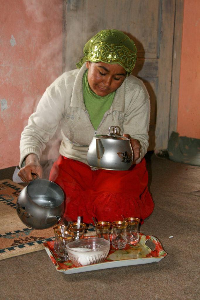 Young Turkish woman making tea.