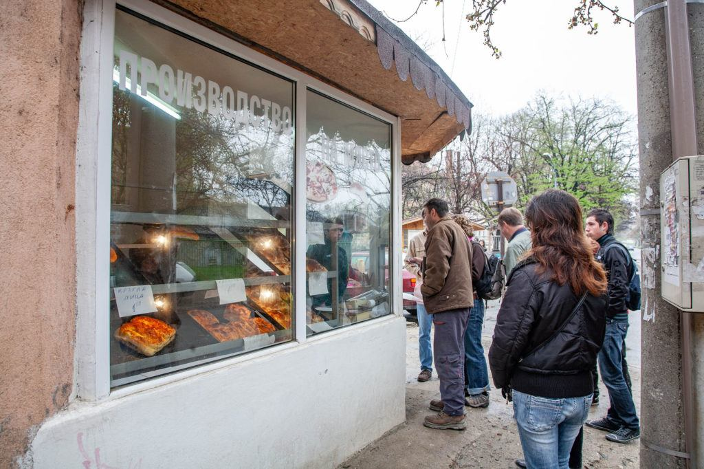 Our new friend helping us buy from this small bakery selling banitsa, a popular breakfast food.