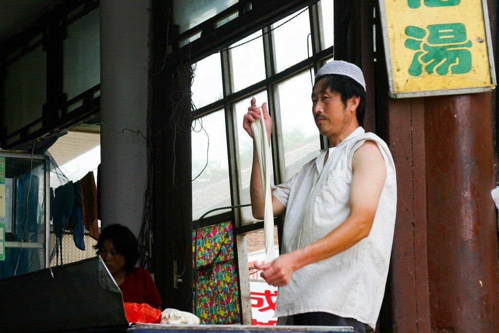Maybe not a Xian Tourist Attraction per se, but wandering the Muslim Quarter is a must-do! This man twirling his dumpling dough mesmerized us!