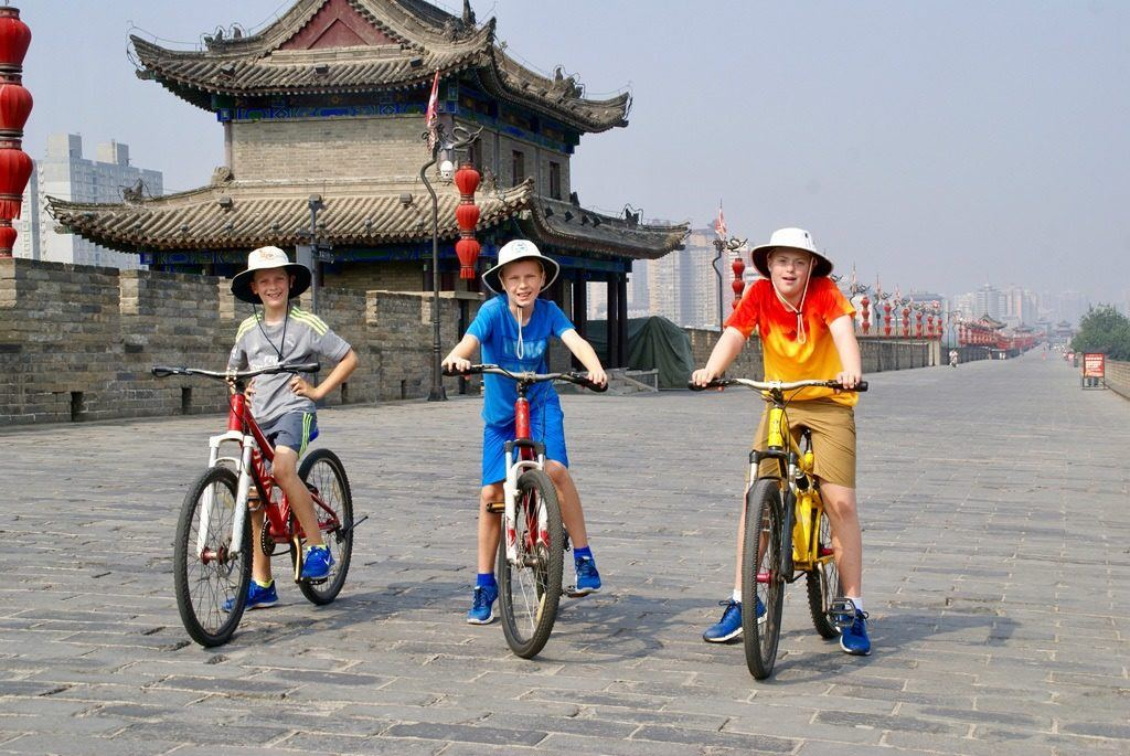 Kids love riding bikes on the walls of Xian. Make sure to put it on your Xian itinerary.