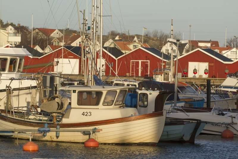 Boats and boat houses in Hono Harbor, Sweden.