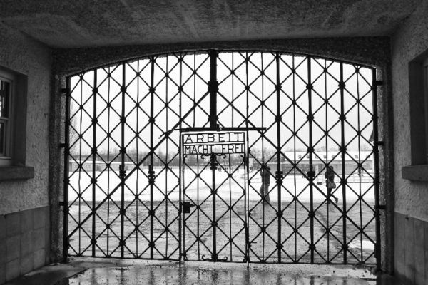 """""""Arbeit Macht Frei"""" are words welded into the gate."""