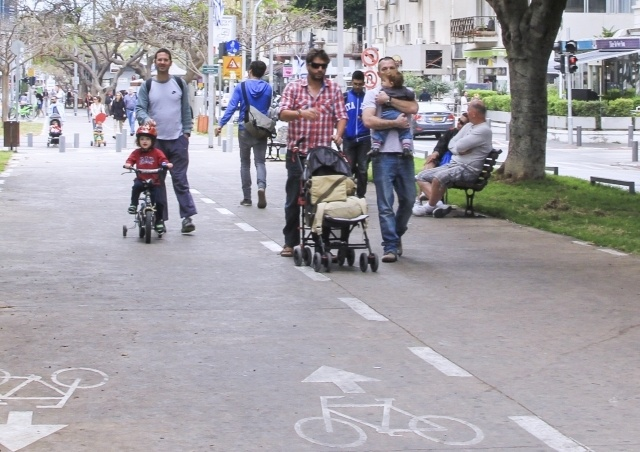 Families out for a stroll in Tel Aviv, Israel.