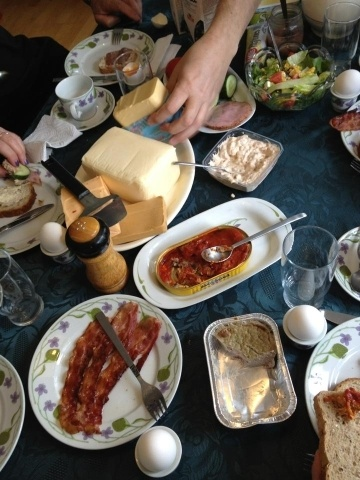 A breakfast table in Norway with a variety of cheeses, fish, and other high protein dishes.