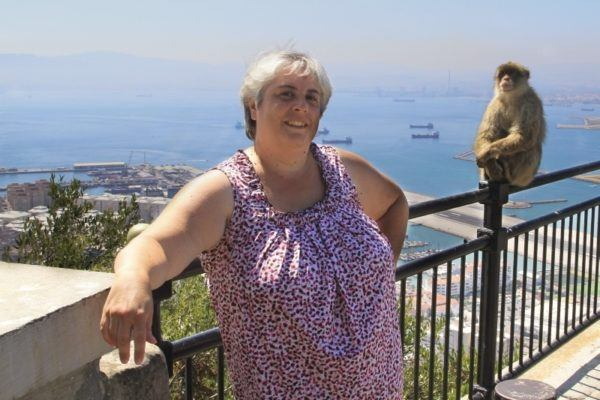 Corinne poses with a Barbary ape high up on the rock of Gibraltar.