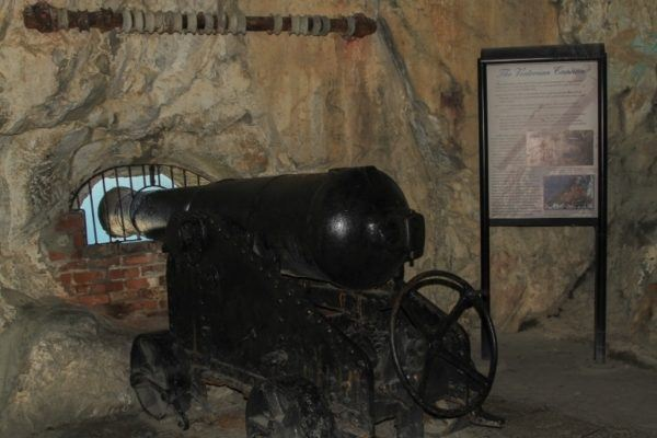 A canon is placed at an enclosure in the tunnels of The Rock of Gibraltar.