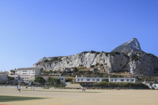 Gibraltar cricket match with the rRock in the background.