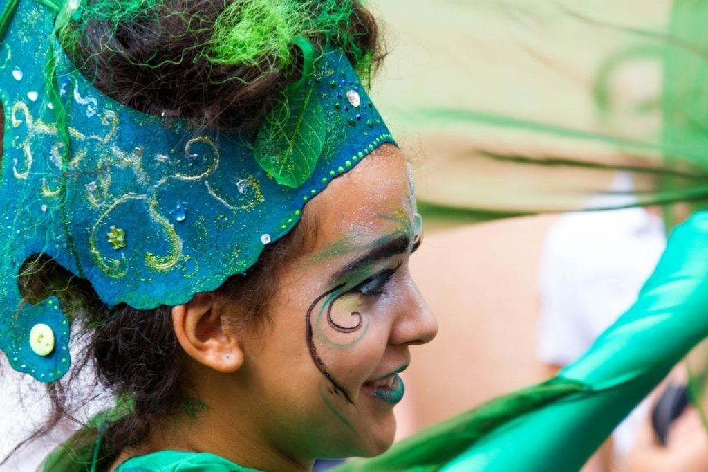 A closeup of a girl's face who is in the parade.