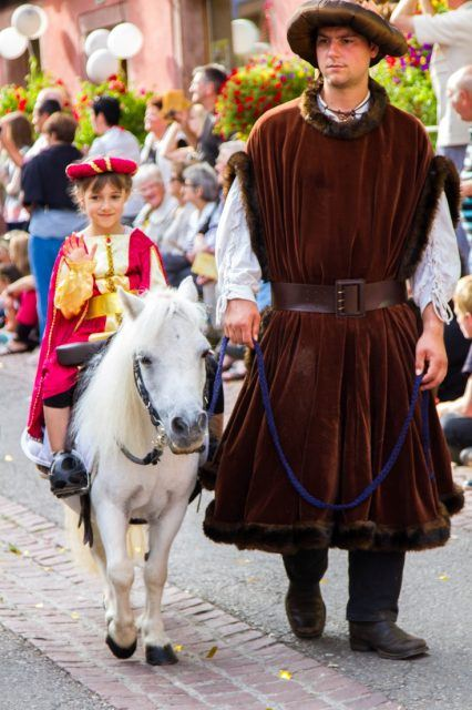 The parade is full of medieval sights, like this little girl riding her pony.