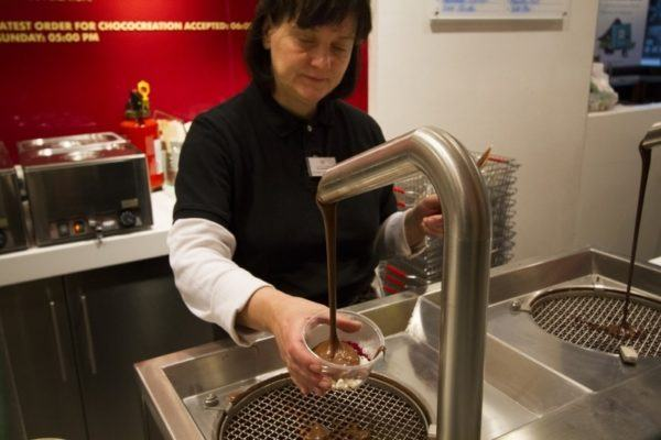 Liquid chocolate being poured into a bowl.