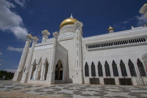 Golden domes and stylish minarets adorn the Omar Ali Saifuddin Mosque.