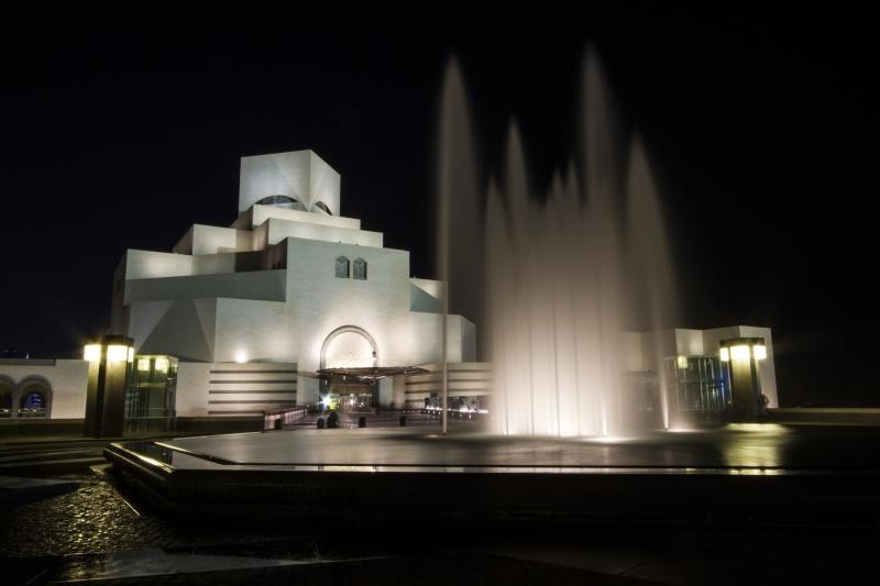 Museum Islamic Art Doha with fountains at night