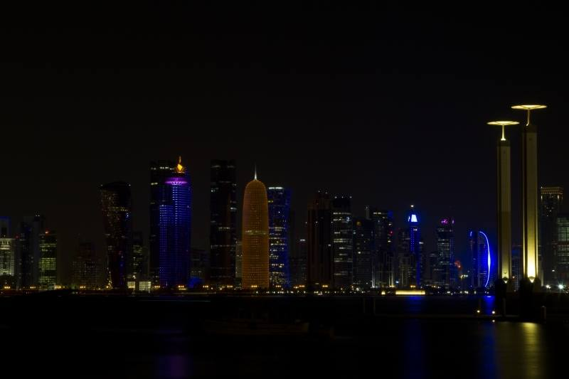 The night skyline of Doha's business district.