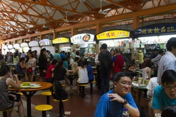 People eating lunch at a hawker center in Singapore.