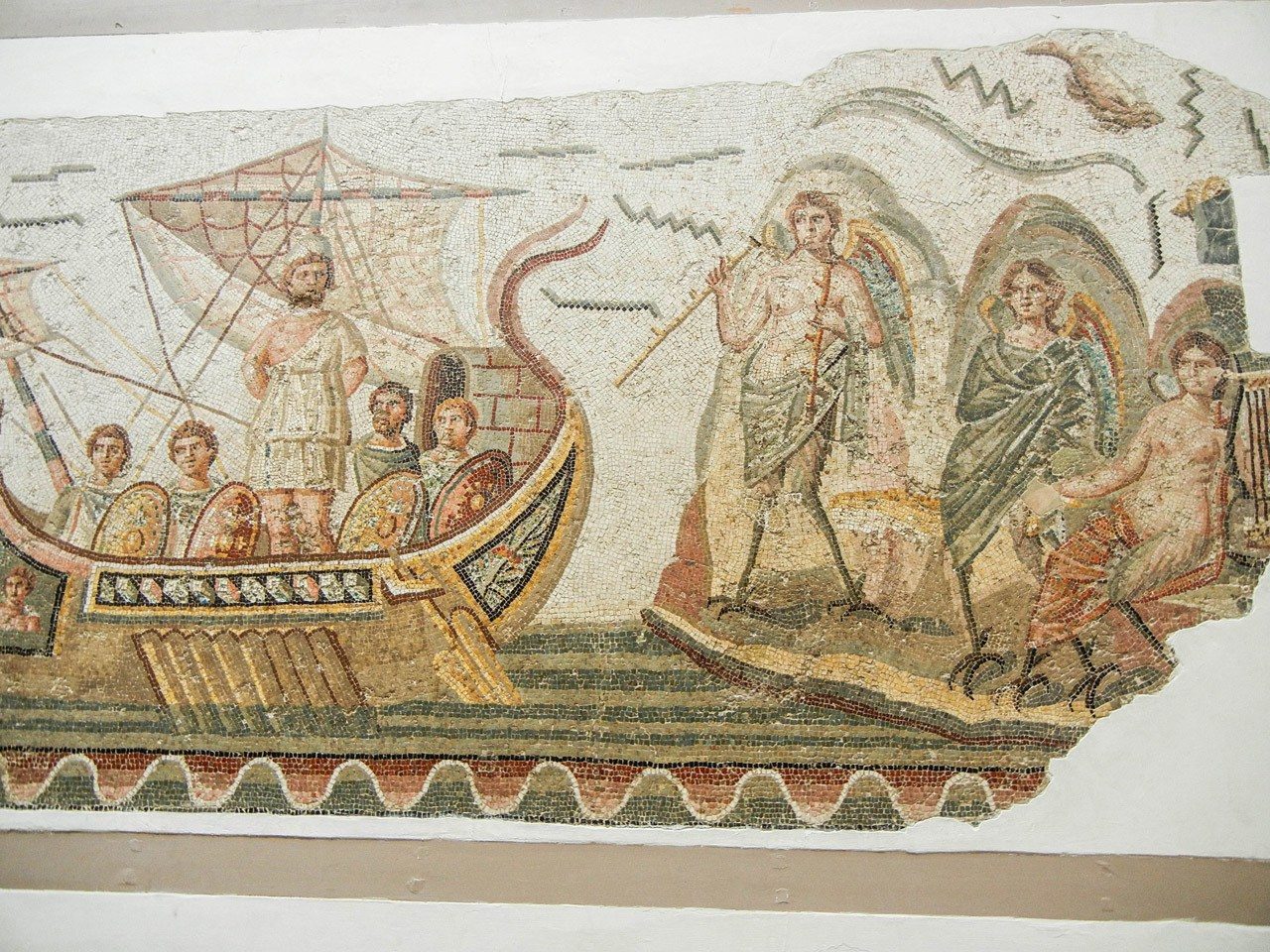 One of the Top things to do in Tunis is the Bardo Museum to see a plethora of stunning mosaics such as this one of the boat and sailors.