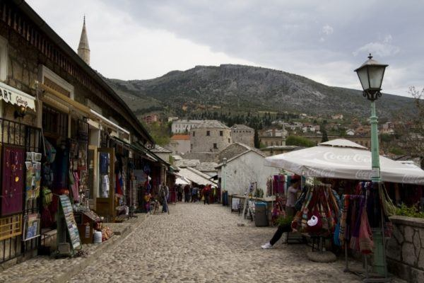 Walking street in Mostar with shopping stalls.