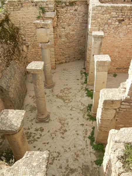 Most of the Roman villas in Bulla Regia have been buried, so you look down to see them.