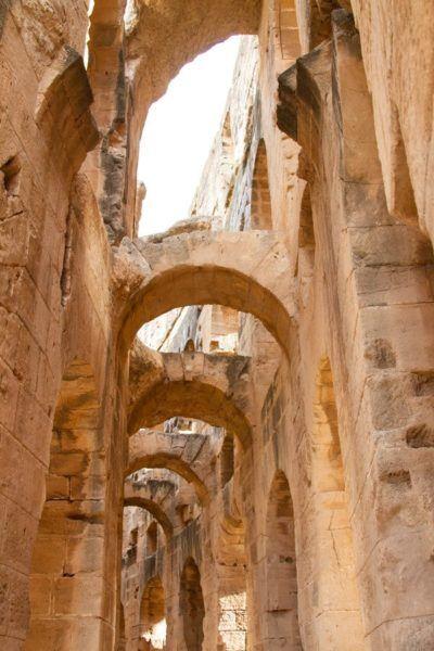 Iconic keystone arches found along the interior corridors of El Jem.