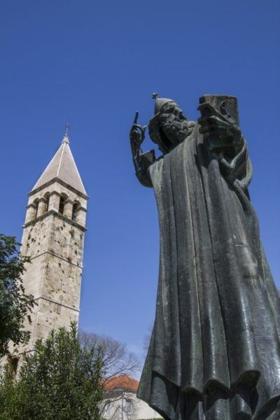 Split statue and bell tower.