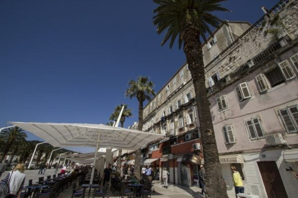 Outdoor cafes along the harbor in Split.