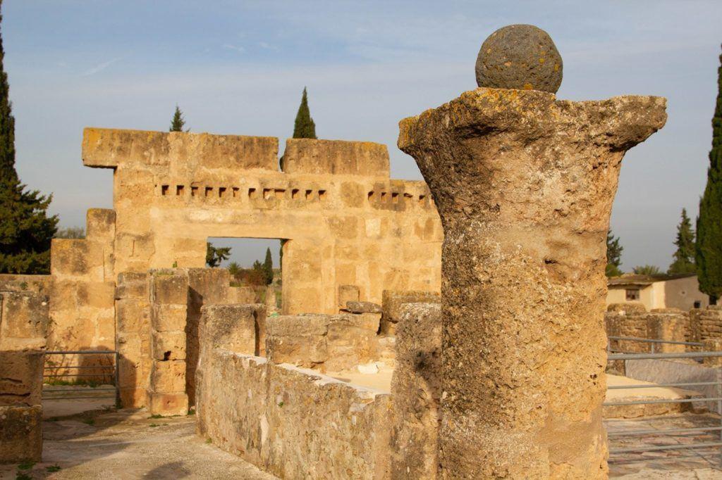 Close up of a column, ball, and arch in Utica, Tunisia.