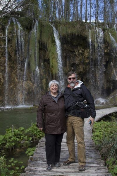 Jim and Corinne in front of waterfall in Plitvice.