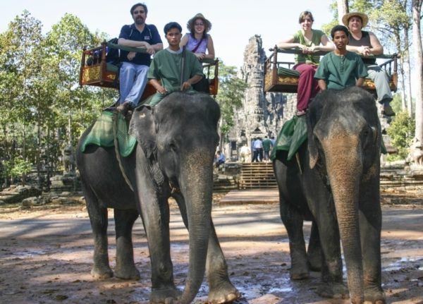 Two elephants take a family for a ride around Bayon temple in Angkor Wat.