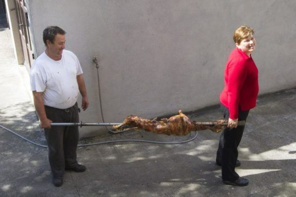 Bringing in the freshly roast lamb, still on the spit.