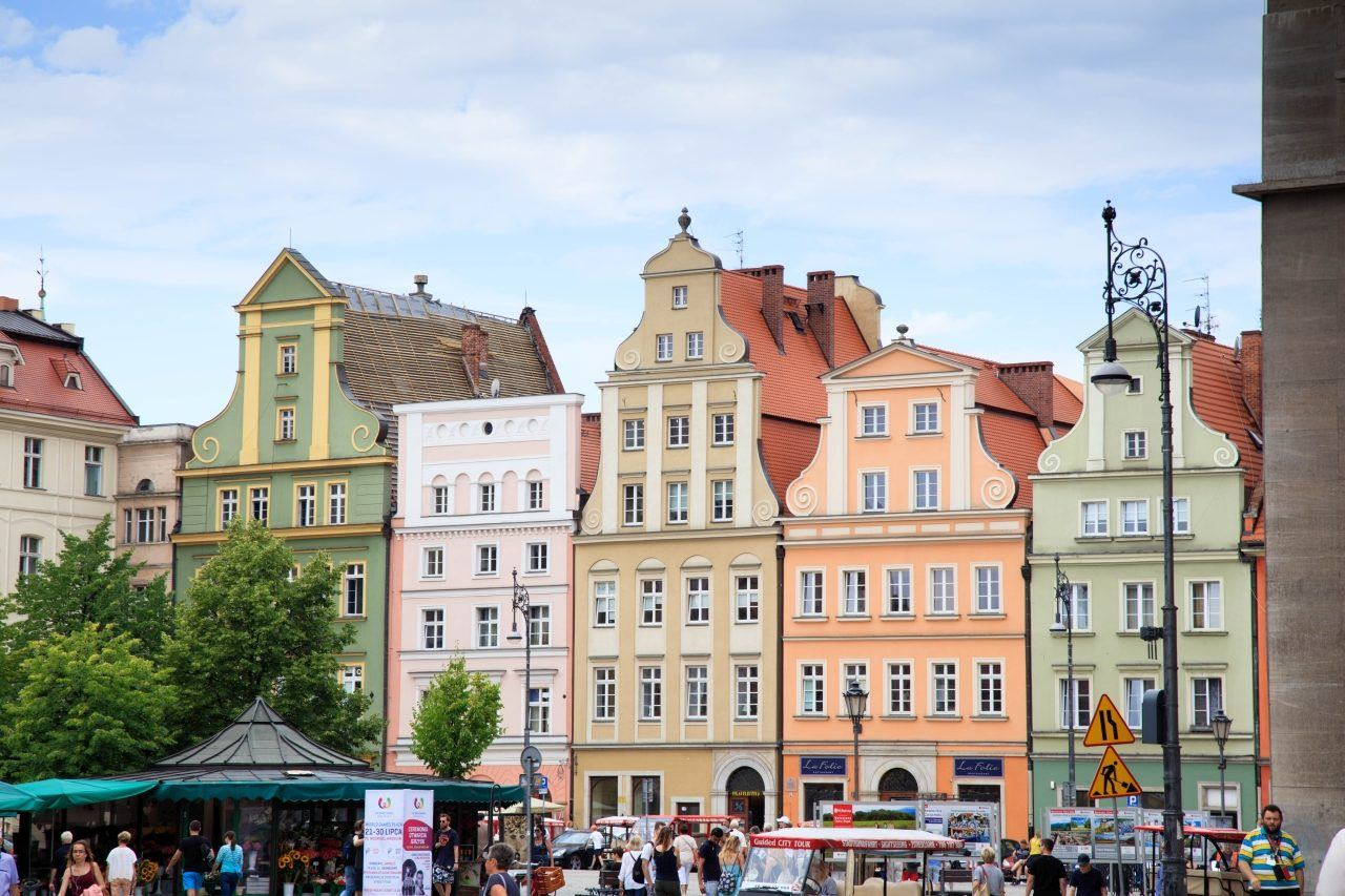 Pastel colored buildings that are reminiscent of Medieval times line the squares in the center of Wroclaw.
