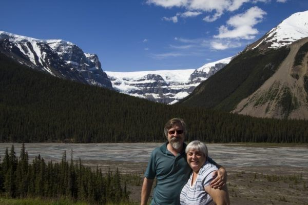 Jim and Corinne with a Canadian Rockies mountain backdrop.