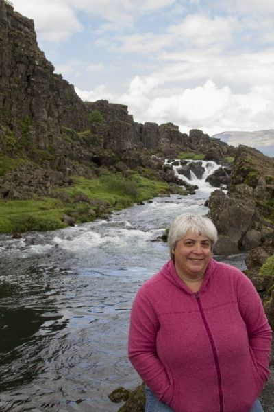 Corinne in front of a small river in Thingvellir National Park.
