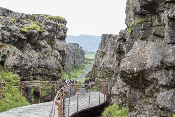 Walking through the continental rift at Thingvellir National Park.