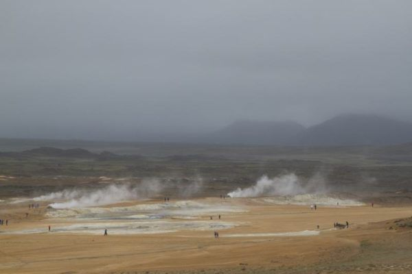 Sulfur pits and steam billowing from the ground at Námafjall Geothermal Area.