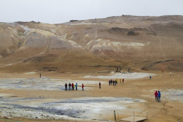 Visitors walk the paths around the boiling mud pots and sulfur pits.
