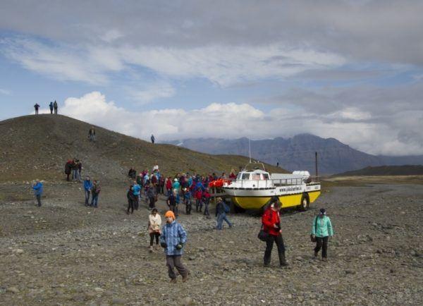 One of the famous yellow amphibious boats waiting to load passengers at Jokulsarlon Glacier Lagoon.