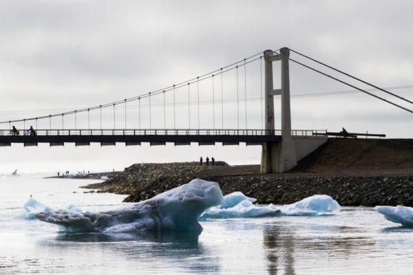 Icebergs heading out to sea under the bridge at Jokulsarlon Glacier Lagoon.