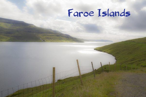 Beautiful view of the ocean and the grass covered slopes of the Faroe Islands.