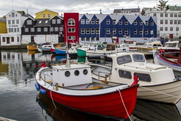 Colorful fishing boats in Torshavn harbor.