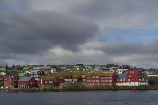 Storm clouds gather above a fishing village in the Faroes.