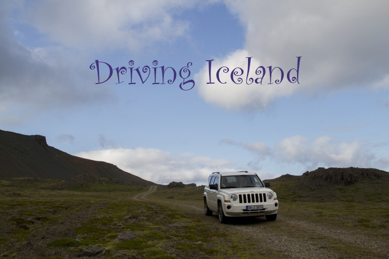 The jeep tackles a narrow dirt track driving in Iceland.