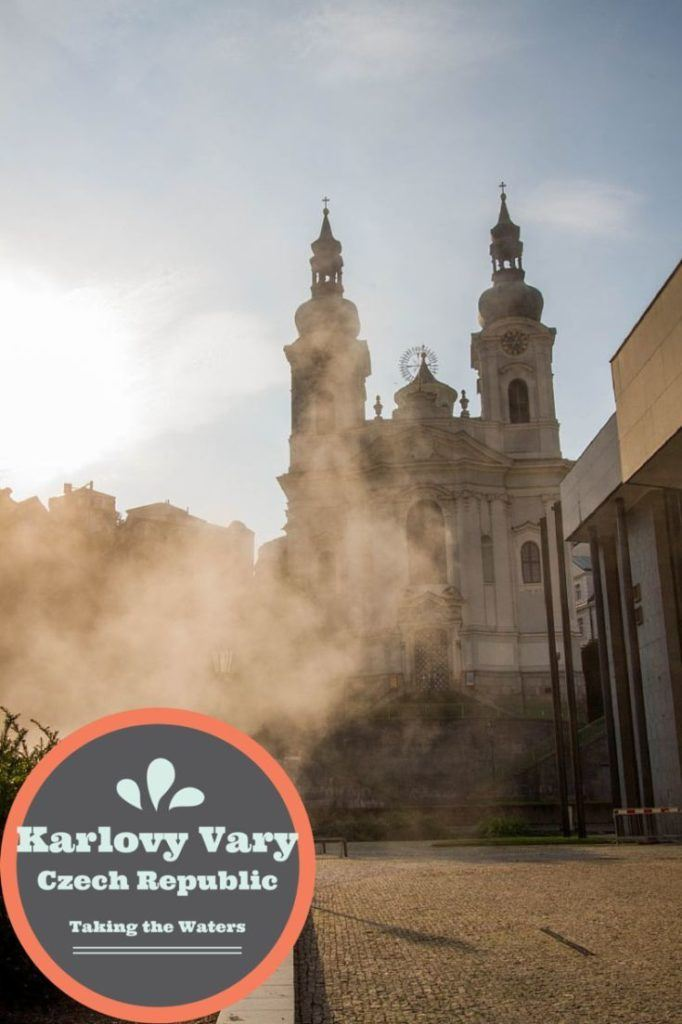 Clouds of steam from the hot springs in front of the St Mary Magdalene's Church in Karlovy Vary.