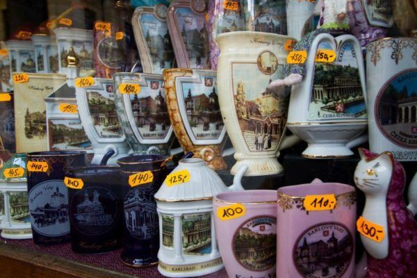 Different souvenir sipping cups at a Karlovy Vary shop.