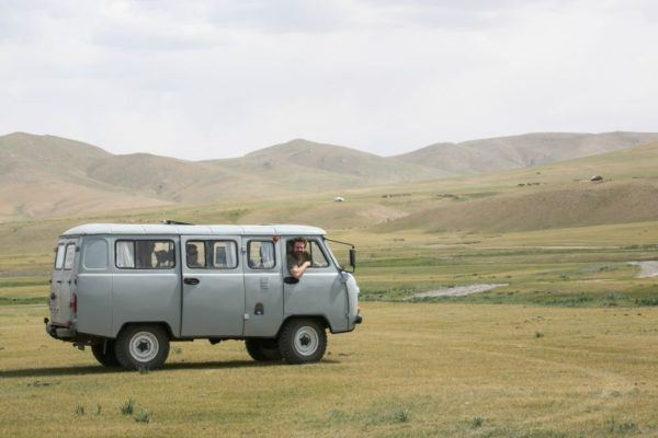 Jim looks out the passenger window of a Russian Military style van in Mongolia.