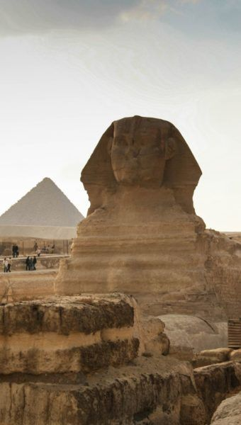 Sphinx with pyramid behind it.