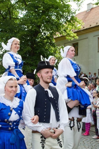 Folk dancers in blue costumes at the Ride of the Kings, Vlčnov.